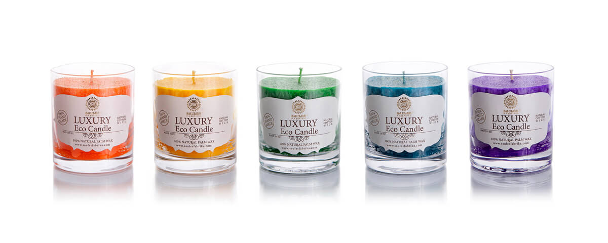 Palm wax candles in glass containers
